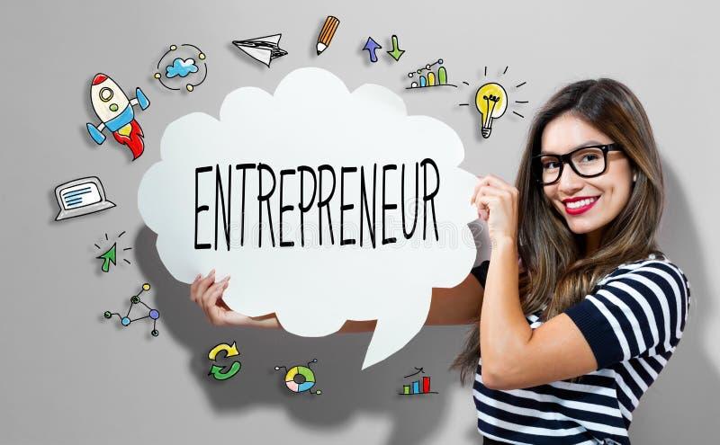 Texte d'entrepreneur avec la femme tenant une bulle de la parole photos stock