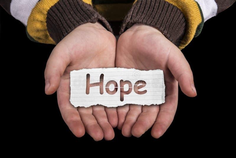 Texte d'espoir en main image stock