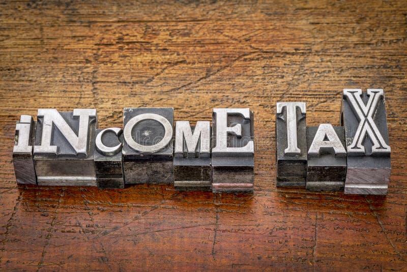 Texte d'impôt sur le revenu dans le type en métal photo libre de droits