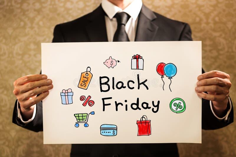 Texte de Black Friday avec l'homme d'affaires image libre de droits