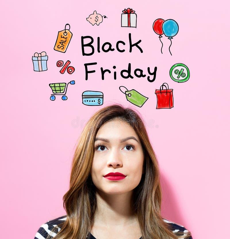 Texte de Black Friday avec la jeune femme photo stock