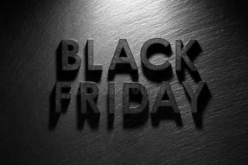 Texte de Black Friday sur l'ardoise noire photographie stock libre de droits