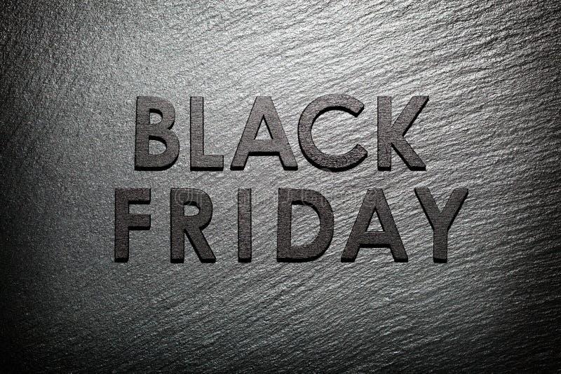 Texte de Black Friday sur l'ardoise noire images libres de droits