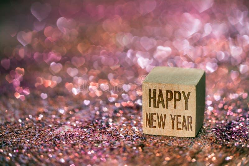 Texte de bonne année avec la lumière de bokeh de coeur photos libres de droits