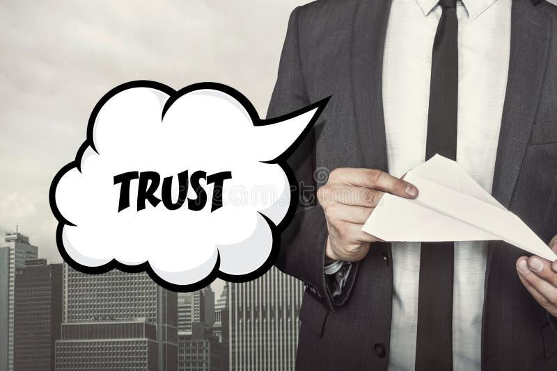 Texte de confiance sur la bulle de la parole avec l'homme d'affaires illustration stock