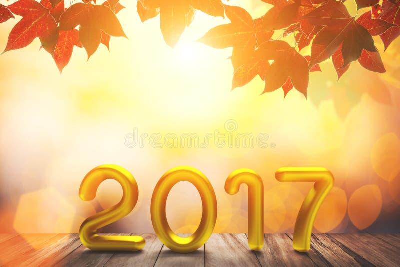 Texte de l'or 2017 sur le vieux bois sur l'érable rouge dans le fond clair d'automne et de bokeh photos libres de droits
