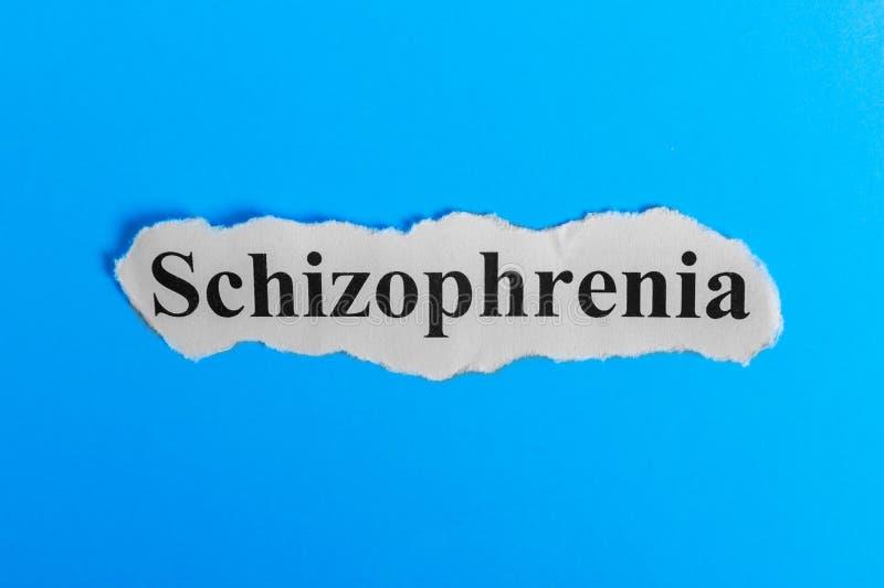Texte de schizophrénie sur le papier Schizophrénie de Word sur un morceau de papier texte debout de reste d'image de figurine de  photos stock