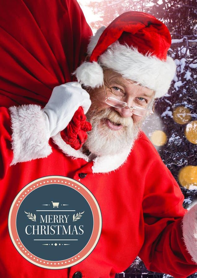 Texte et Santa de Joyeux Noël avec le fond de scintillement de bokeh de lumières image stock