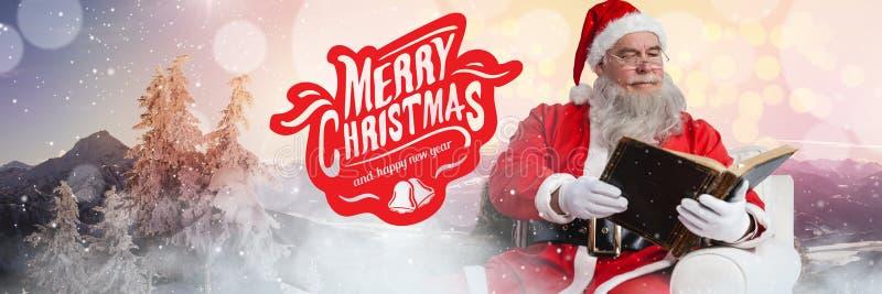 Texte et Santa de Joyeux Noël lisant un livre photographie stock libre de droits