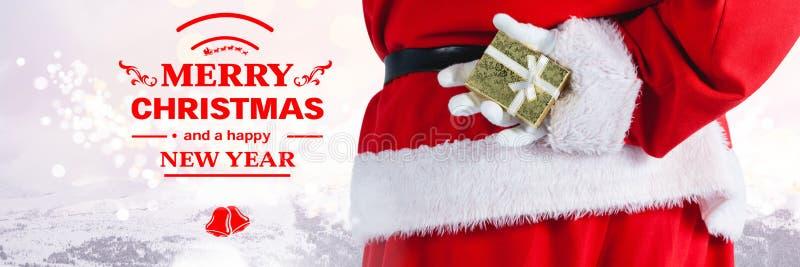 Texte et Santa de nouvelle année de Joyeux Noël avec le cadeau image libre de droits