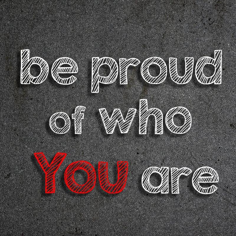 Texte et x22 ; Soyez fier de qui vous l'are& x22 ; écrit sur un tableau illustration stock