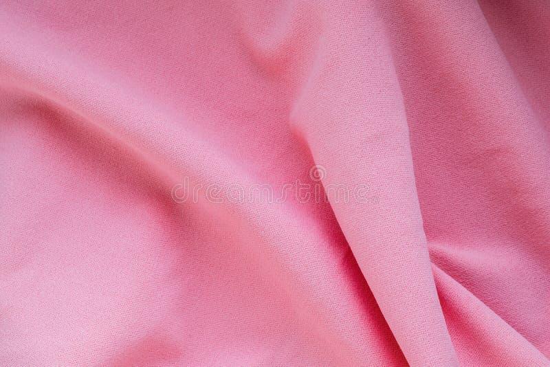Textiel en textuurconcepten Close-up van roze golvende stof als achtergrond Hoogste mening royalty-vrije stock fotografie