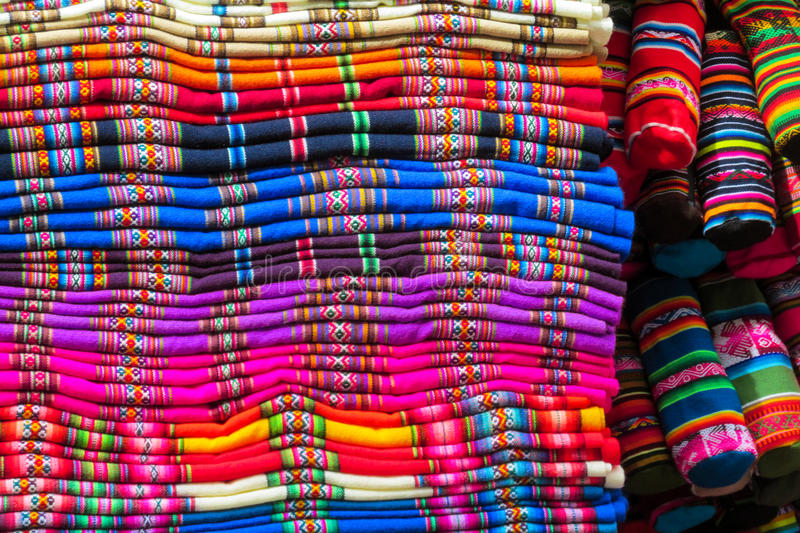 Textil in Peru. Traditional covers, scarf shop. Red, yellow, blue, green, violet colour covers lie in a stack stock photography