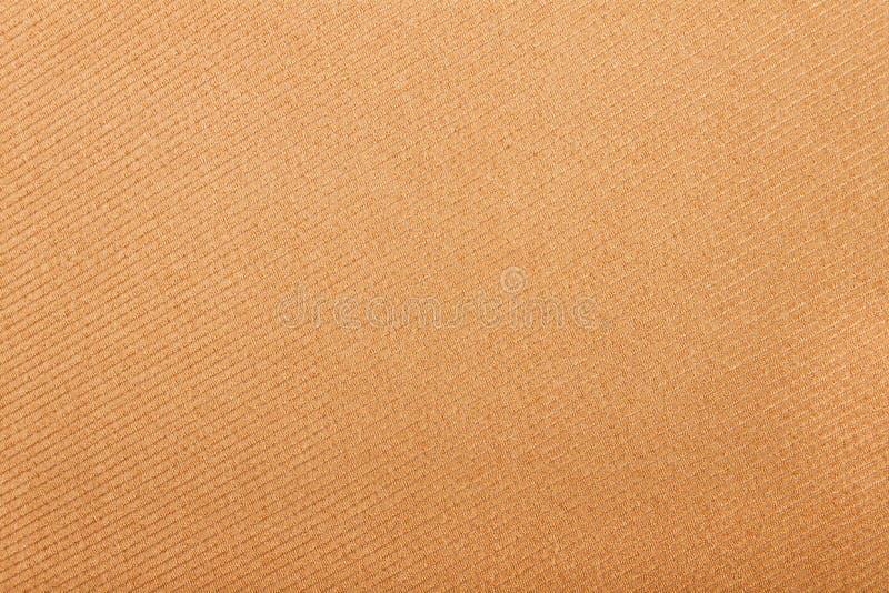 Textilbeigehintergrund stockfoto