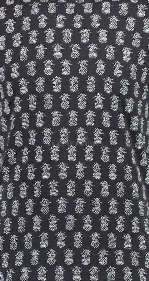 textile Μαύρο υπόβαθρο με τον άσπρο ανανά στοκ εικόνα