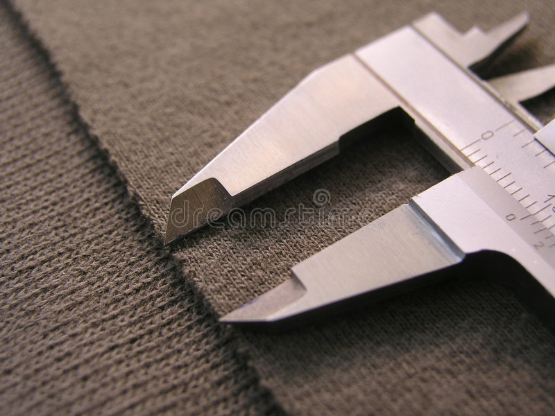 Textile. Brown material and measuring device stock photography