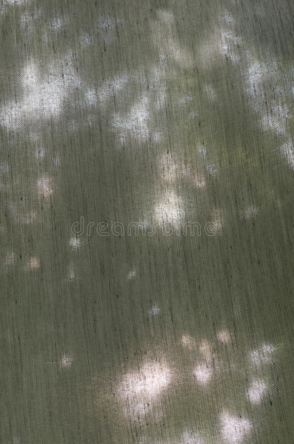 Textile background. Grey transluent courtain textile background royalty free stock photography