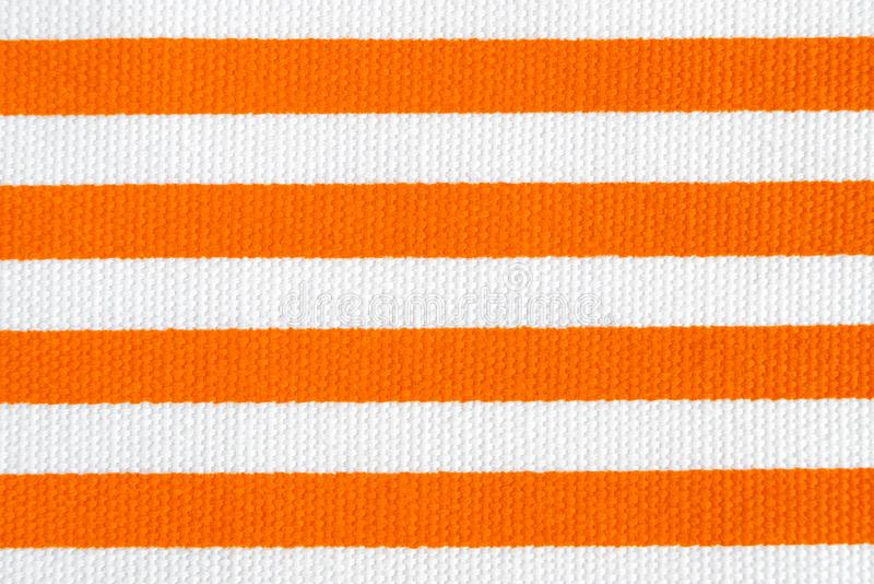 Textile background with orange and white stripes. Fabric texture royalty free stock photos