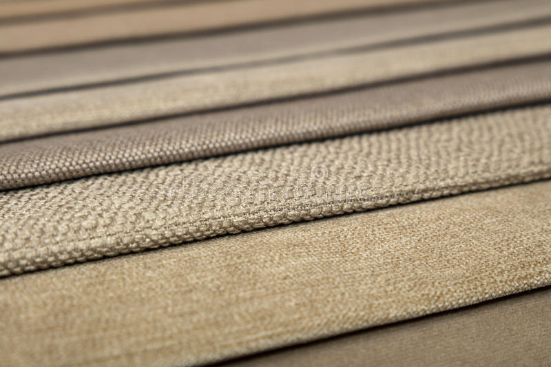Textile catalogue, colorful fabric samples. Colorful beige fabric samples swatch in textile catalogue palette, selection of different colors and textures range stock photo