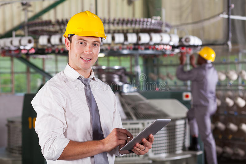 Textile factory manager stock photo