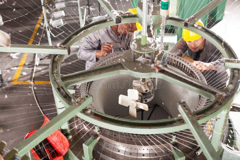 Textile factory technicians stock photo