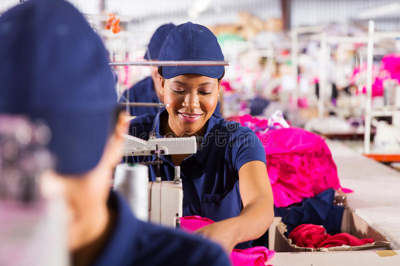 Textile factory workers. African textile factory workers on production line royalty free stock photography