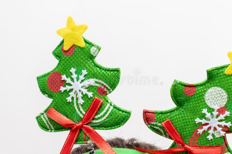 Textile green christmas tree wuth decorations on white background - xmas party concept stock photos