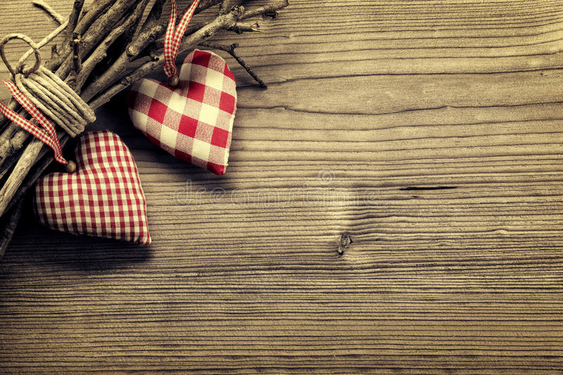 Textile hearts on twig - Harmony background royalty free stock photography