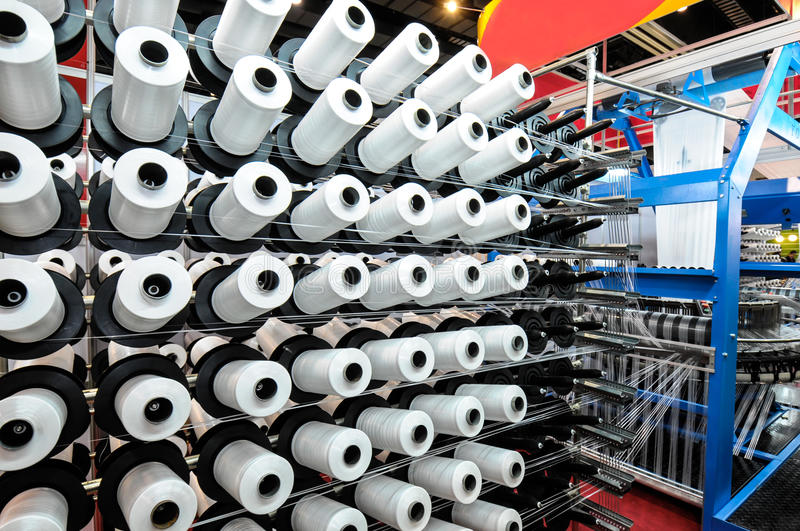 Textile industry. Weaving and warping stock photo