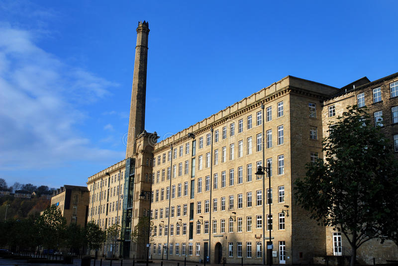 Textile mill with chimney. Disused textile mill in Halifax, West Yorkshire stock image