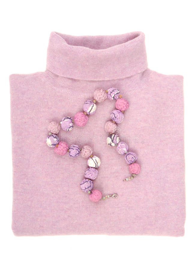 Textile necklace and wool sweater. stock photo