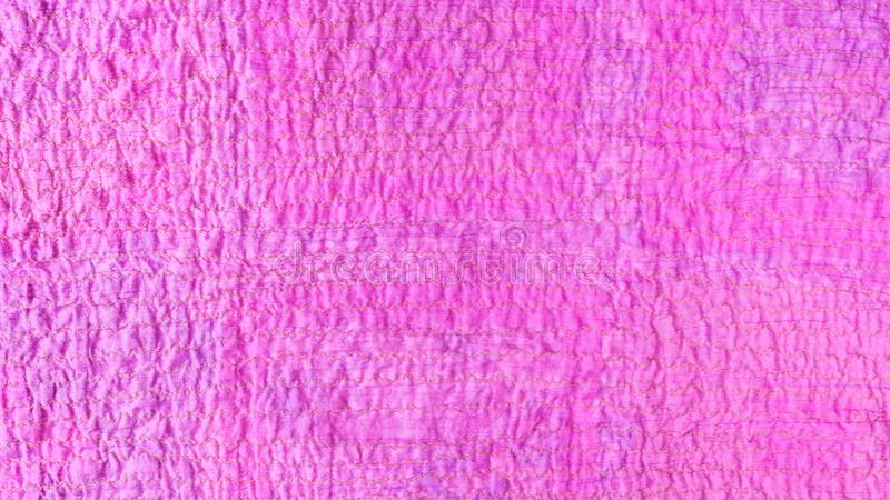 Pink textured surface of scarf from crushed cotton. Textile panoramic background - pink textured surface of scarf stitched from crushed cotton fabric royalty free stock images