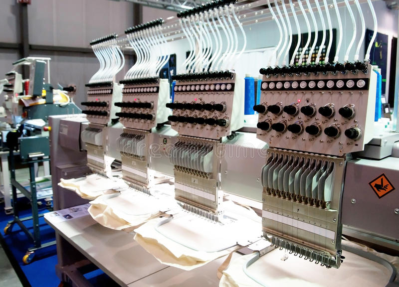 Textile - Professional and industrial embroidery machine. Machine embroidery is an embroidery process whereby a sewing machine or embroidery machine is used to royalty free stock photos