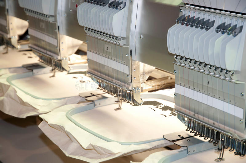 Textile - Professional and industrial embroidery machine. Machine embroidery is an embroidery process whereby a sewing machine or embroidery machine is used to royalty free stock image