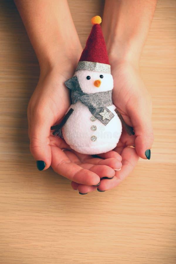 Textile snowman woman hands wooden table studio royalty free stock photos