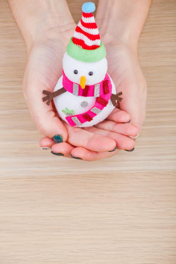 Textile snowman woman hands wooden table studio royalty free stock images