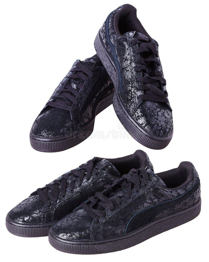 Black slip-on shoes isolated on a white background. stock photo