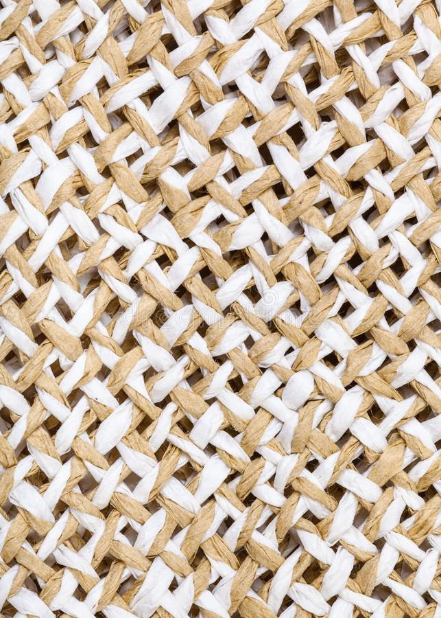 Weaving of straw hat from natural toyo fibers royalty free stock photography