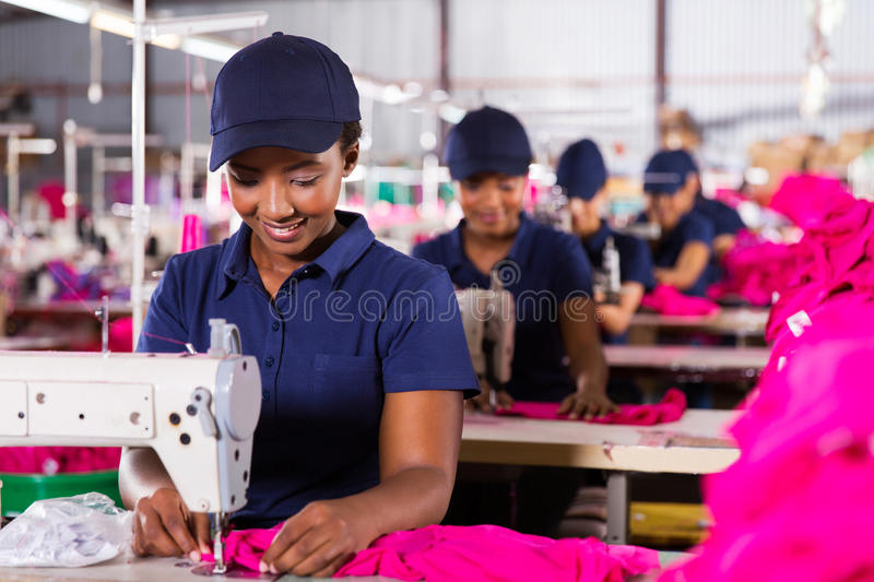 Textile worker sewing royalty free stock images