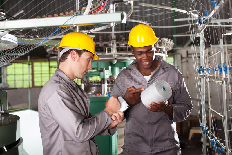 Textile workers discussing stock photos