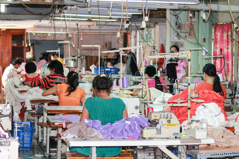 Textile workers in a small asian factory stock photos
