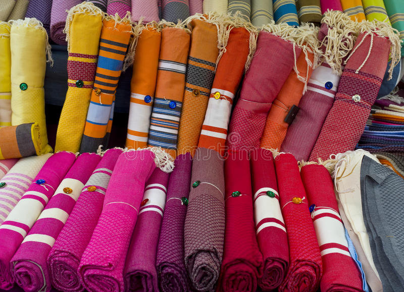 Textiles, Aix-en-Provence France. Bright, colorful woven, textile place mats are rolled up for sale in an outdoor marketplace in Aix en Provence, a major tourist stock images