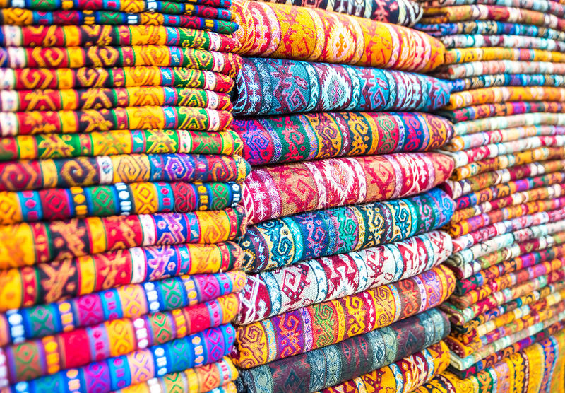 Textiles and Clothing at the bazaar. The Turkish market royalty free stock images