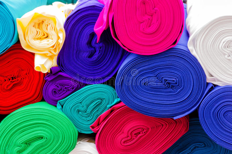 Textiles. On a market in Ecuador stock images
