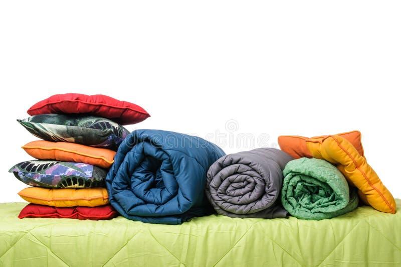 Textiles, pillows, blankets on the mattress stock photo