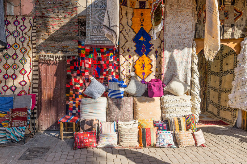 Textiles for sale in the souks of Marrakesh. Marrakesh, Morocco - December 8, 2016: Textiles for sale in the famous souks of Marrakesh, Morocco, Africa. The sun` royalty free stock image