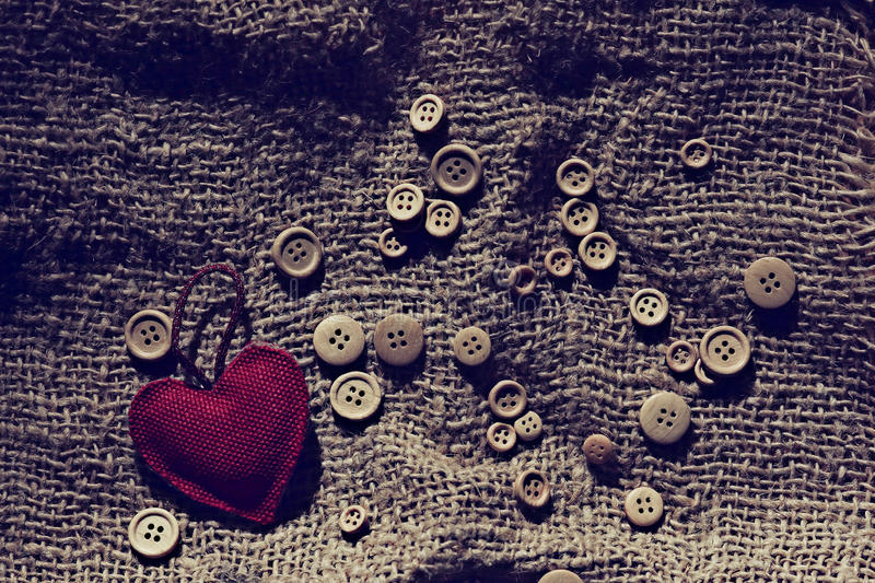 Textiles valentine heart. Among buttons stock photography