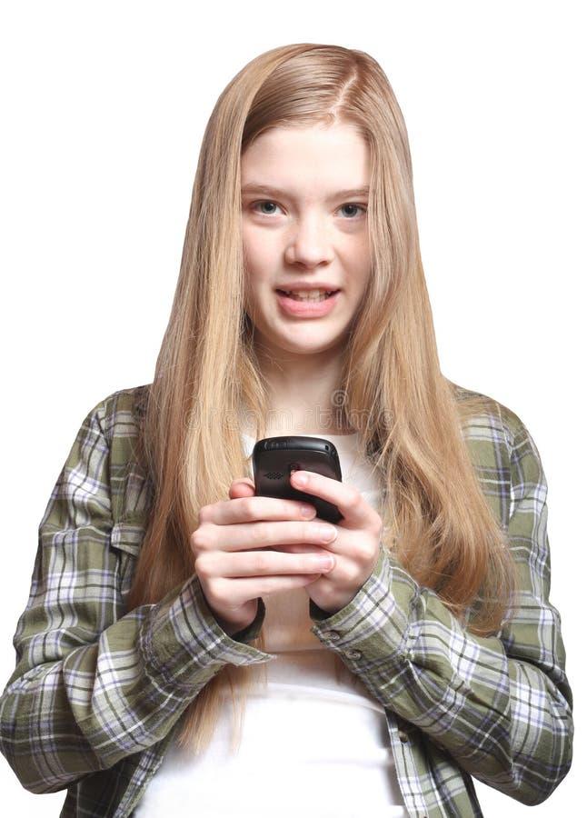 Texting adolescente imagem de stock royalty free