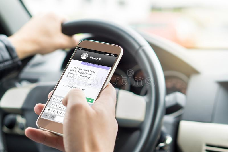 Texting while driving car. Irresponsible man sending sms. stock photos