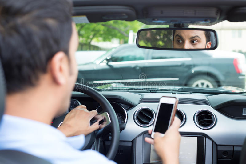 Texting and driving cause traffic accidents stock photography